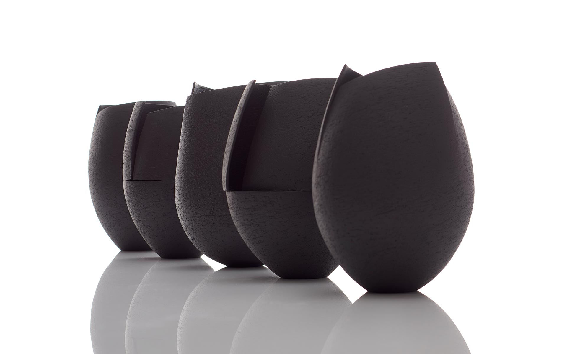 Group of Small Black Cut Vessels