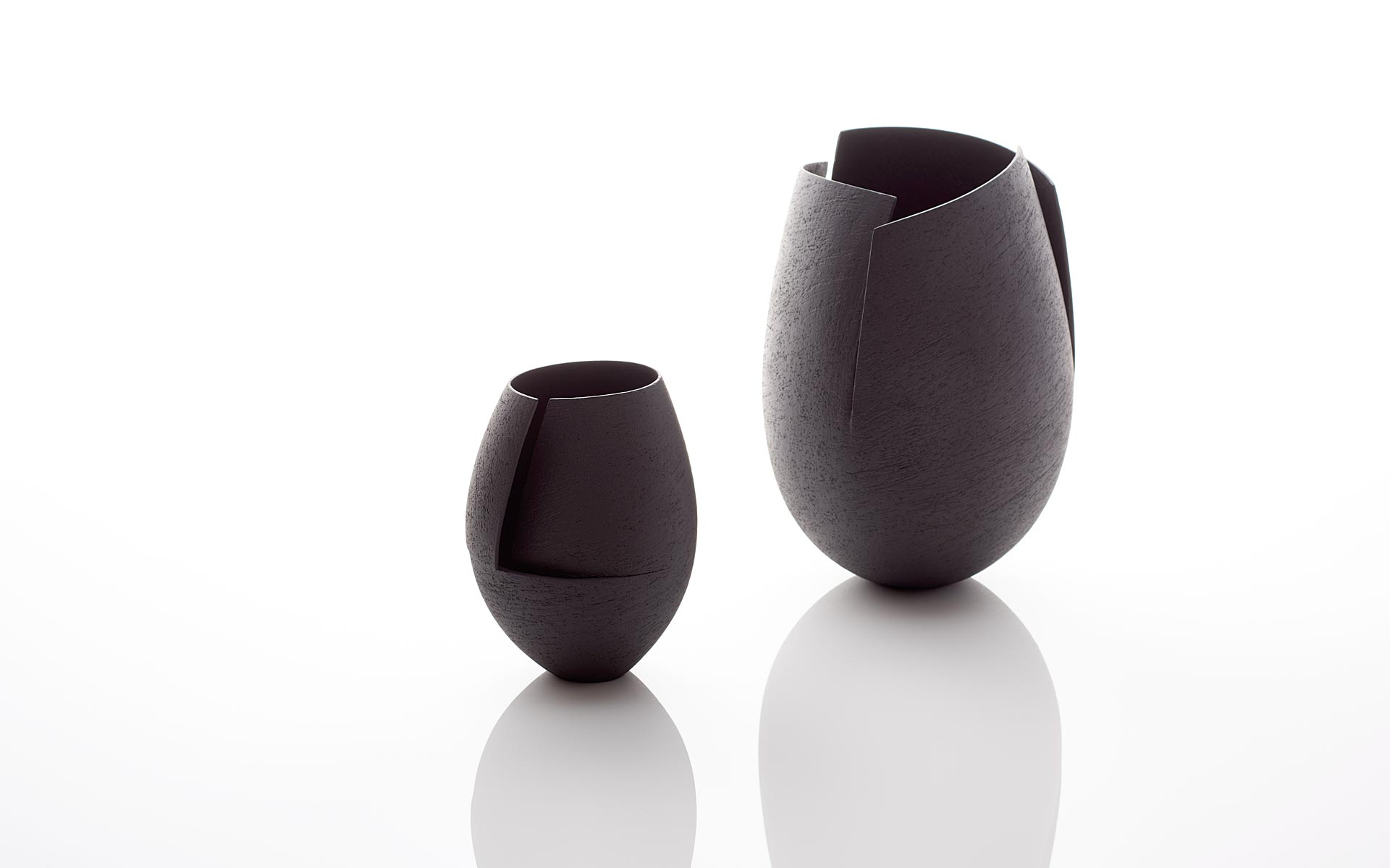Two Black Cut Vessels
